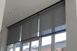Roller Blinds or curtains at the glass window.