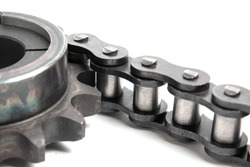 Roller chain and drive sprocket on a white background