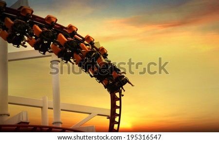 Roller Coaster loops in the sunset