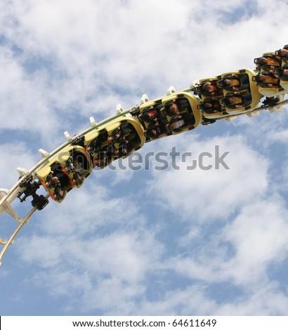 Roller coaster twisting upside down