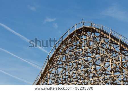Roller coaster with blue sky on background