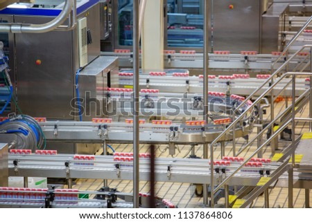 Roller conveyor pack up of flowing milk box to sell