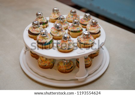 Roller Derby Skating Party Cupcakes with Disco Ball Garnish on a Cake Carrier