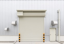 Roller door or roller shutter. Also called security door. Motorized type or automatic system. For safety or protect commercial and industrial building i.e. warehouse, factory, hangar shop and store.