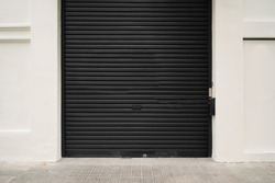 Roller garage door in black. Horizontal and empty