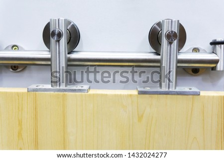 Roller mechanism for sliding doors. Exhibition copy on the stand in the store. #1432024277