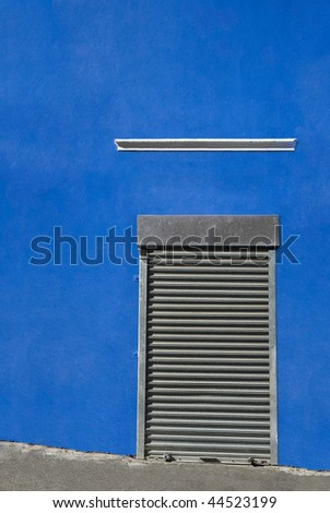 Roller shutter doors with big blue wall covering frame