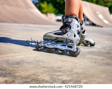 Roller skate legs close up  in skatepark. Low section. Roller skates is extreme sport. #421468720