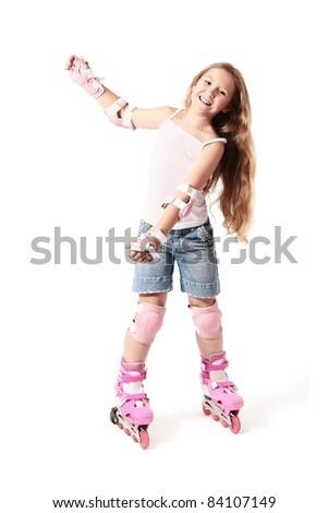 Roller skater child girl on the rollers. Driving on roller skates. Smiling girl on the roller-skates isolated on white background.