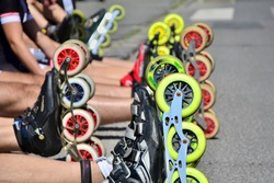 Roller skates wheels before the start of city race for healthy and active life