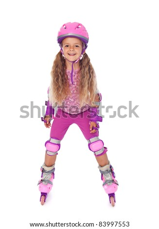 Roller skating little girl with protective gear, laughing - isolated