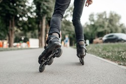 Roller skating, skater rolling, back view on legs