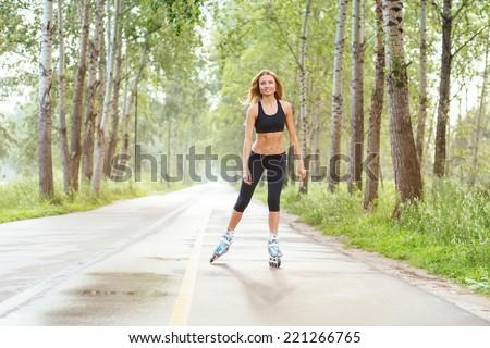 Roller skating sporty girl in otdoor. Caucasian woman in outdoor fitness activities.