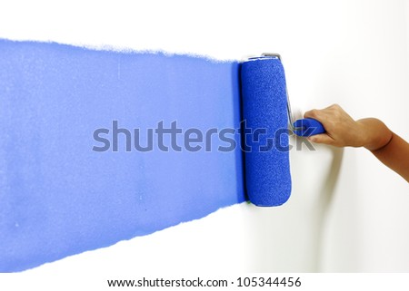 Roller with paint on the wall