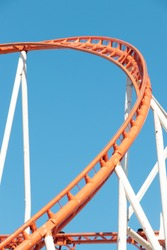 Rollercoaster on a sunny cloudless sky.