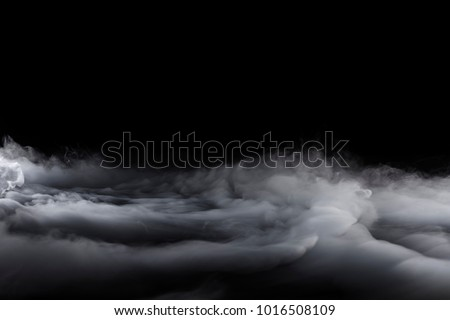 Rolling Billows of Dry Ice fog blowing from the left to the right into clouds #1016508109