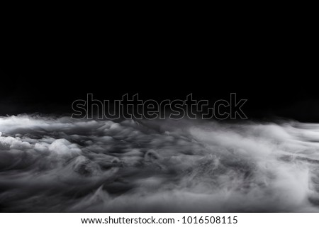 Rolling billows of swirling clouds from dry ice across the bottom even light