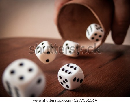 Rolling Dices on a Table #1297351564