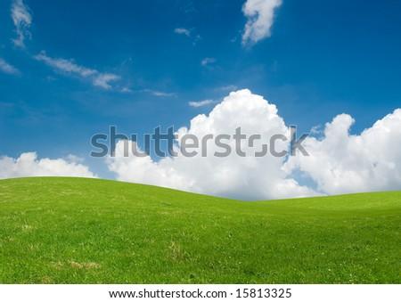 Rolling green hills under a blue summer sky.