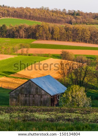 Rolling hills, farm fields, and a barn in Southern York County, Pennsylvania. #150134804