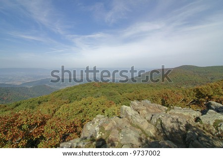 rolling hills of the blue ridge mountains with rocky cliffs
