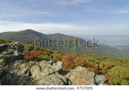 rolling hills of the blue ridge mountains with rocky cliffs - stock photo