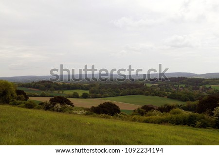 Rolling landscape of fields in the south of England, overcast cloudy day