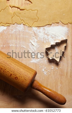 Rolling pin with dough and cookie cutter for christmas