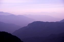 Rolling purple mountain  sunset