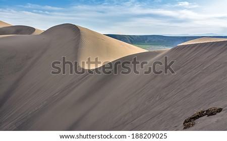 Rolling sand dunes in the desert