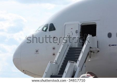 Rolling stairs placed at the airplane doors, ready for boarding
