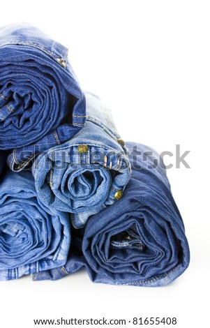 Rolls of Blue Jeans isolated on white background with copy space for your text