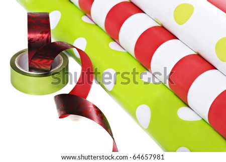 Rolls of gift wrapping paper and ribbon on a white background with space for text