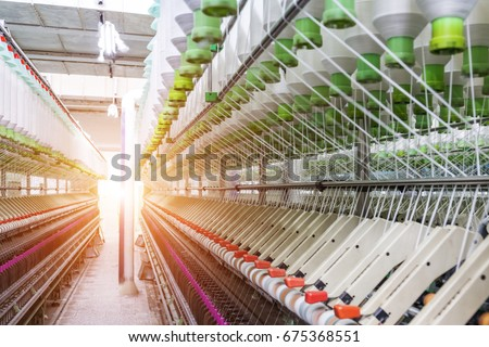 Shutterstock Rolls of industrial cotton fabric for clothing cloth textile manufacture on machine