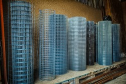 Rolls of iron mesh (wire mesh) use for reinforce concrete in construction site. Metal grid. Grid of pending orders. Metal mesh in rolls.