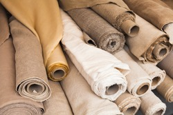 Rolls of  linen cloth lie on the market counter