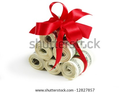 Rolls of money wrapped in red bow and ribbon