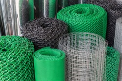 Rolls of plastic and steel wire mesh in various sizes and patterns