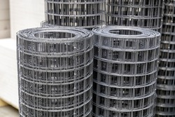 Rolls of steel wire mesh. Material for reinforce concrete in building