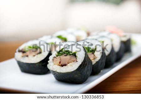 Rolls with shiitake mushrooms served on a plate