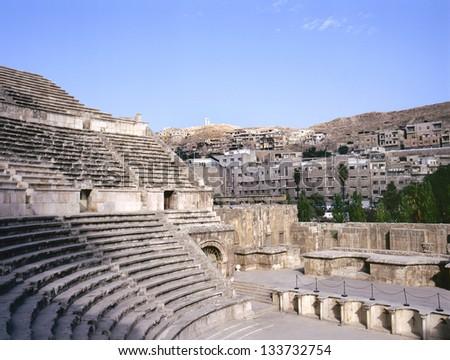 Roman amphitheater in Amman, at background the city of Amman in Jordan