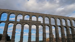 Roman aqueduct in Segovia, Spain. Famous Romanesque architecture is located in the Spanish province of Castilla.