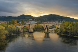 Roman Bridge of Ourense in a sunset with a spectacular light
