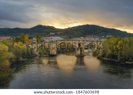 Roman Bridge of Ourense in a sunset with a spectacular light Foto stock ©