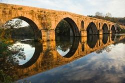 Roman bridge of Ponte do Porto at sunset in Braga, the north of Portugal