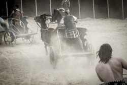 Roman chariot in a fight of gladiators, bloody circus