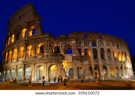 Roman colosseum landmark in night light