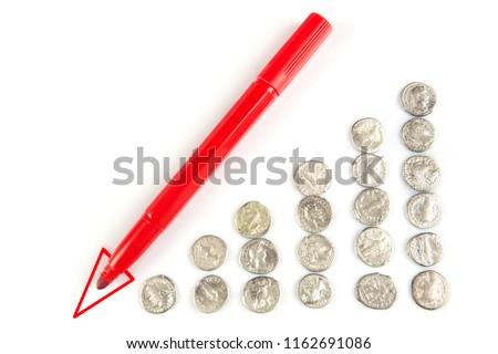 Roman denarius and arrow diagram lie on a white background, the  #1162691086