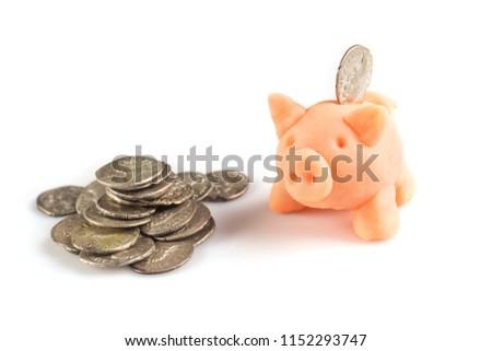 Roman denarius and piggy money box lie on a white background #1152293747