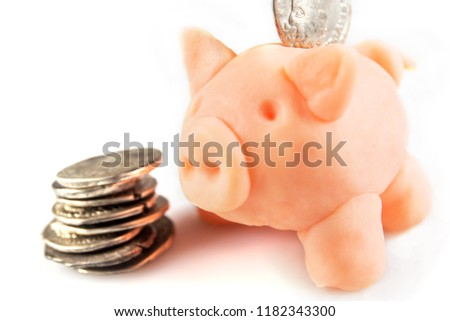 Roman denarius and piggy money box lie on a white background, th #1182343300